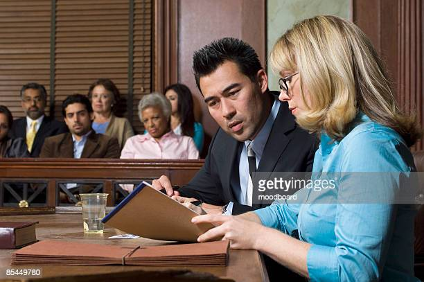 lawyer defending client with jury in court - witness stock pictures, royalty-free photos & images