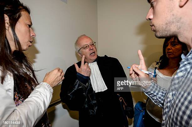 A lawyer defending the Belgian royal family Alain Berenboom speaks to journalists on September 9 2013 at the Court of First Instance in Brussels...