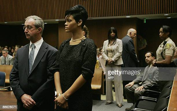 Lawyer Donald Etra stands with singer Rihanna inside the Los Angeles Superior Court during the hearing in the Chris Brown felony assault case on June...