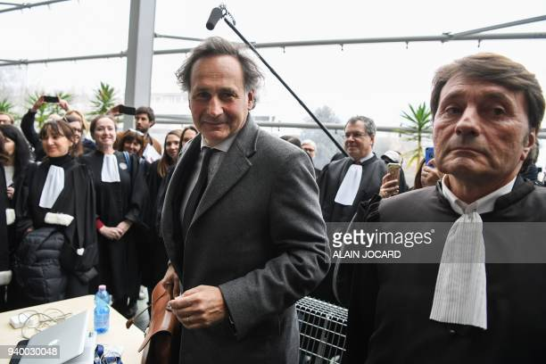 Lawyer for Laura Smet daughter of late French singer Johnny Hallyday PierreOlivier Sur reacts as he arrives at the Nanterre Regional courthouse...