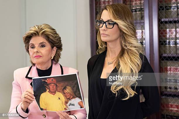 Lawyer, Gloria Allred, holds a picture of jessica drake and Donald Trump during a news conference in Los Angeles, California on October 22, 2016....