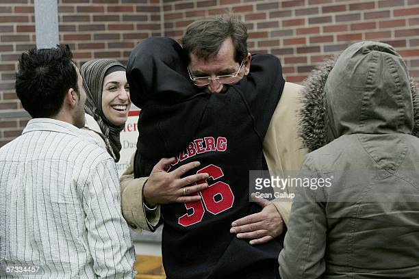 Lawyer Heinz Moeller hugs Songol Surucu sister of Alpaslan and Mutlu Surucu as sister Arsu Surucu other brother Emhra Surucu and a friend look on...