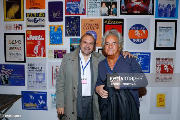 Lawyer Herve Temime and Producer Albert Koski attend Albert Koski exposes its RockRoll Posters Collection at Galerie Laurent Godin on June 03 2019 in...
