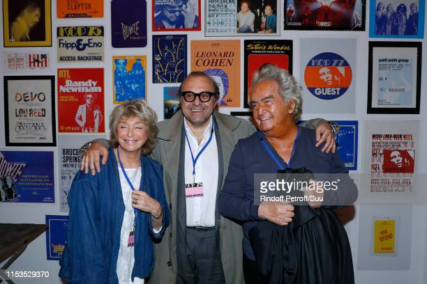 Lawyer Herve Temime standing between Producer Albert Koski and his wife Director Daniele Thompson attend Albert Koski exposes its RockRoll Posters...