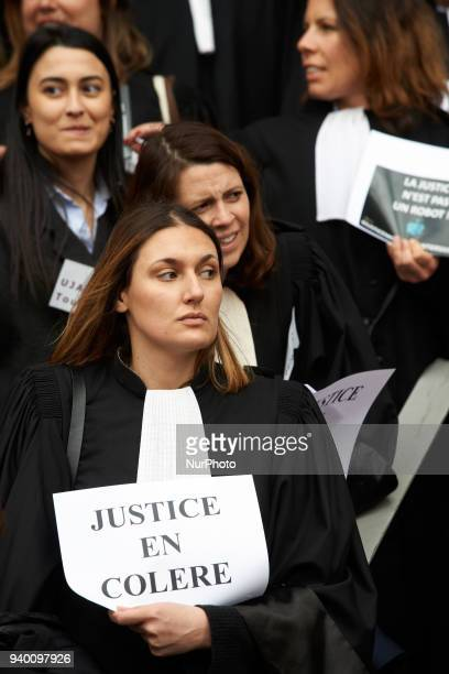 A lawyer holds a placard reading 'Angry Justice' The French Bar Association all lawyers' unions all magistrates' unions called all its members to be...