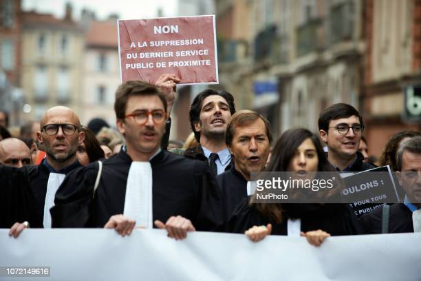 A lawyer holds a placard reading 'No to the suppression of the last proximity public service' Lawyers counsels and magistrates gathered in front of...