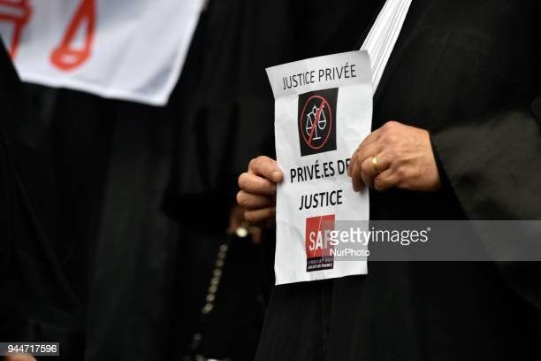 A lawyer holds a placard reading 'Private justice stripped of justice' The French Bar Association all lawyers' unions all magistrates' unions called...