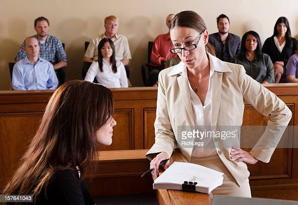 lawyer in a courtroom - trial stock photos and pictures