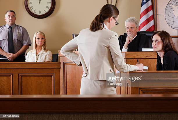 lawyer in a courtroom - domestic violence stock pictures, royalty-free photos & images