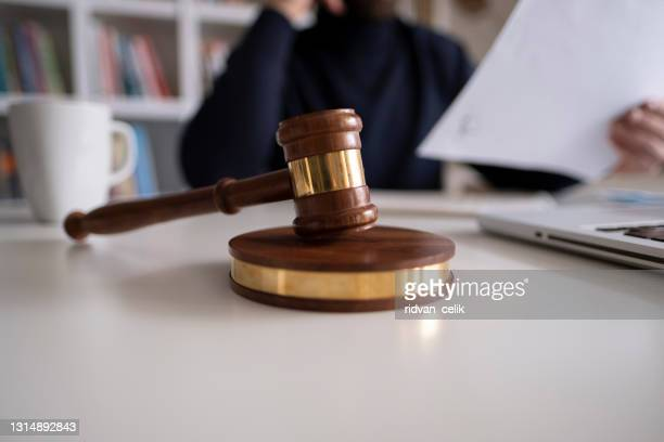 lawyer in office with gavel, symbol of justice - legal system stock pictures, royalty-free photos & images