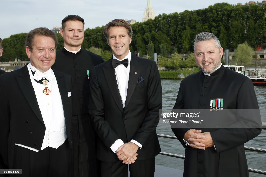 Lawyer Jean-Louis Bosteels, Abbee Gregoire Prichodko, Prince Emmanuel Philibert de Savoy and Abbee Franck Certin attend Charity Gala to Benefit the 'Chretiens D'Orient' on June 8, 2017 in Paris, France.