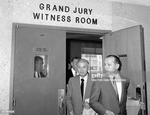 Lawyer Joe Panzer holds door as organized crime figures including Aniello Dellacroce follow him from Queens grand jury room