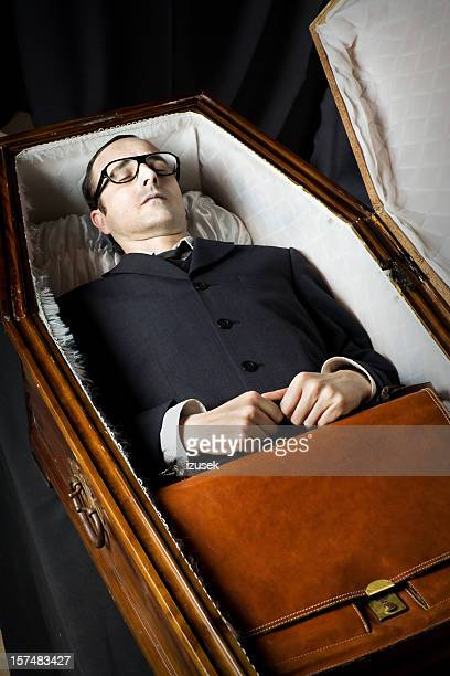 lawyer lying in coffin - coffin stock pictures, royalty-free photos & images