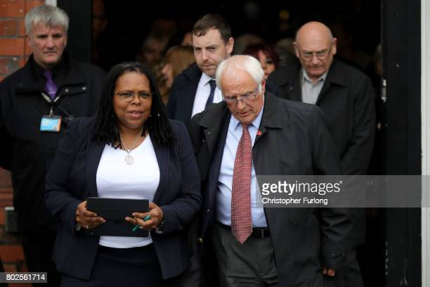 Lawyer Marcia Willis Stewart and Trevor Hicks leave to address the media after the families of the 96 Hillsborough victims were told the decision...
