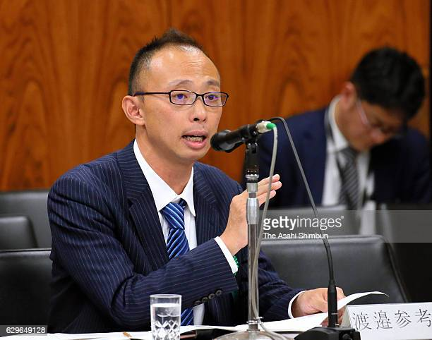 Lawyer Masayuki Watanabe speaks during the Upper House Committee on Cabinet which deliberate the casino bills on December 12 2016 in Tokyo Japan The...