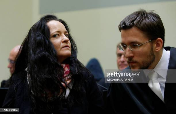 Lawyer Mathias Grasel and defendant Beate Zschaepe wait in a courtroom before the proclamation of sentence in her trial as the only surviving member...