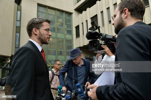 Lawyer Mathias Grasel talks to medias in front of the regional court in Munich after the proclamation of sentence in the trial against his defendant...