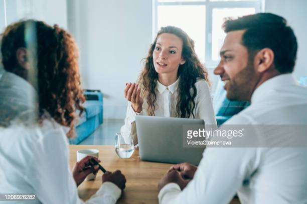 lawyer on a meeting with young couple. - lawyer stock pictures, royalty-free photos & images