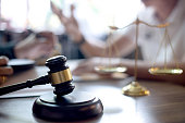 Lawyer or judge gavel with balance handshake