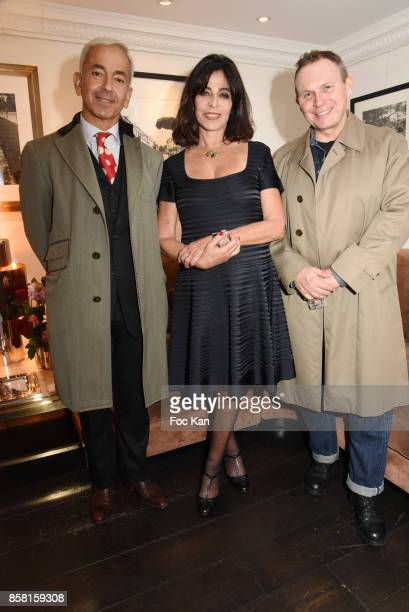 Lawyer Pascal Narboni Dominique Rizzo wife of Willy Rizzo and a guest attend La Guerre D'Indochine By Willy Rizzo Press Preview at Studio Willy Rizzo...