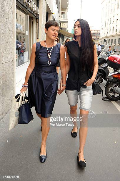 Lawyer Patrizia Bugnano walks with her client Ambra Battilana from the courthouse after the verdicts in the 'Ruby bis' case on July 19 2013 in Milan...