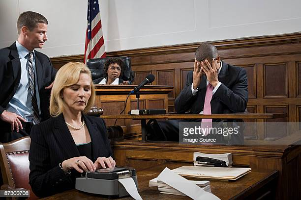 a lawyer questioning a suspect - judge law stock pictures, royalty-free photos & images