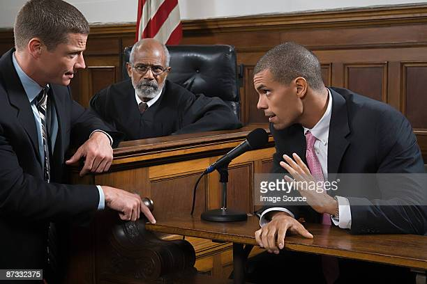 a lawyer questioning a suspect - courtroom stock pictures, royalty-free photos & images