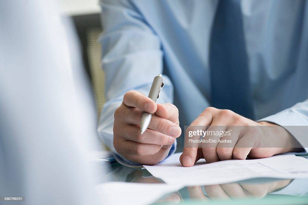 Lawyer reviewing document with client : Stock Photo