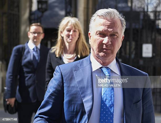US lawyer Richard Fields leaves the High Court in London following a decision on his divorce settlement with estranged wife Russianborn Ekaterina...