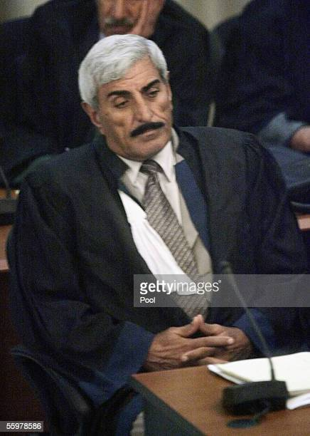 Lawyer Saadoun Sughaiyer alJanabi one of two attorneys for defendant Awad Hamed alBandar one of seven Baath Party officials being tried looks on...