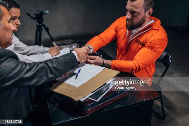 lawyer shaking hands with prisoner - prisoner stock pictures, royalty-free photos & images