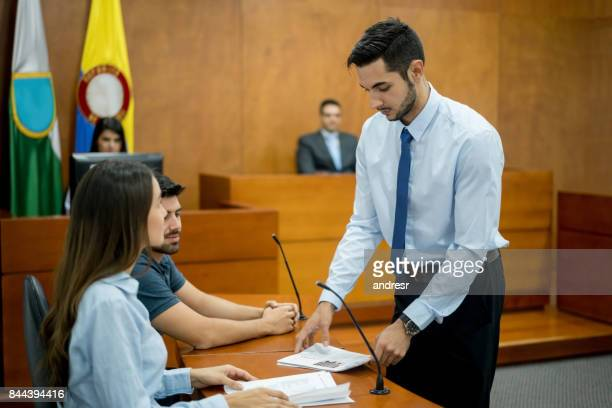 Lawyer showing evidence in trial at a Colombian courtroom