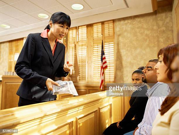 Lawyer showing the jury a piece of evidence