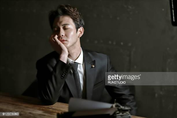 lawyer sitting at desk - 手を顔にやる ストックフォトと画像