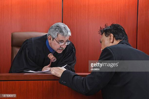 Lawyer Speaking With Judge in Courtroom
