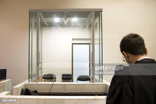 A lawyer stands in front of a glass cage in a courtroom on January 15 in Nanterre's courthouse near Paris Lawyers from all over France pleaded on...
