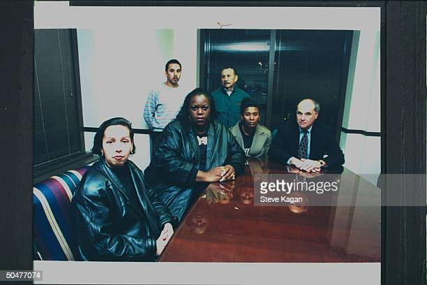 Lawyer Thomas Jacobson sitting w clients Janie Hagen Rey Guerrero Caroline Smith Pablo Guerrero Rita Isbell in his office re family of victims of...
