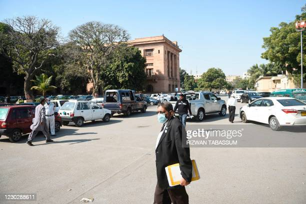Lawyer walks as a high court ordered to release Omar Saeed Sheikh on the murder case of American journalist Daniel Pearl, outside the Sindhhigh...