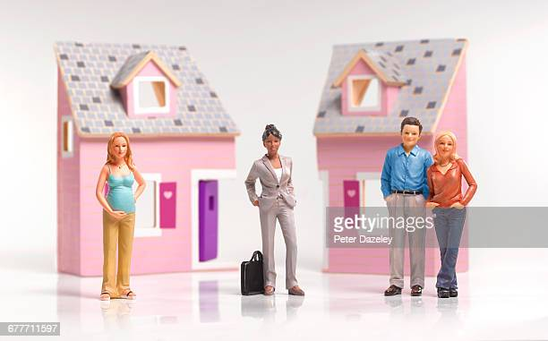 lawyer with divorce couple - figurine stock pictures, royalty-free photos & images
