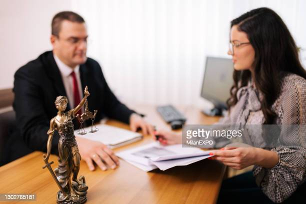 lawyer with the client - legal system stock pictures, royalty-free photos & images