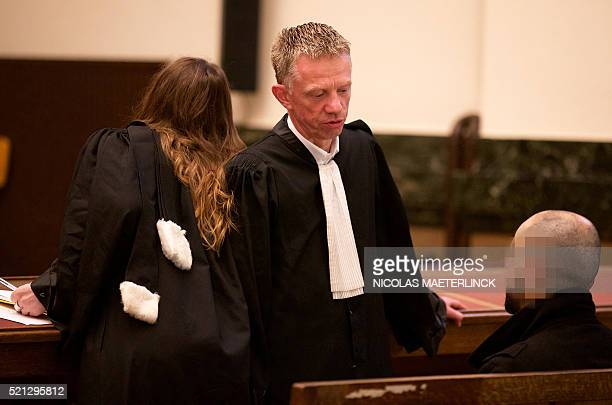 Lawyer Xavier Carette speaks to his client during the introduction of the trial on the terrorist cell of Verviers at the Brussels correctional court...