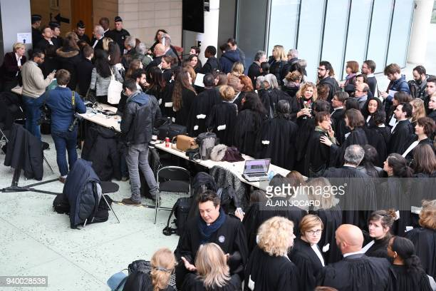 Lawyers and magistrates gather at the entrance hall of the courthouse in Nanterre outside Paris on March 30 as part of a nation wide day of protest...