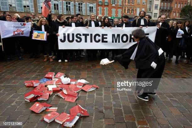 Lawyers and magistrates throw differents justice codes on the ground in protest Lawyers counsels and magistrates gathered in front of the Toulouse'...