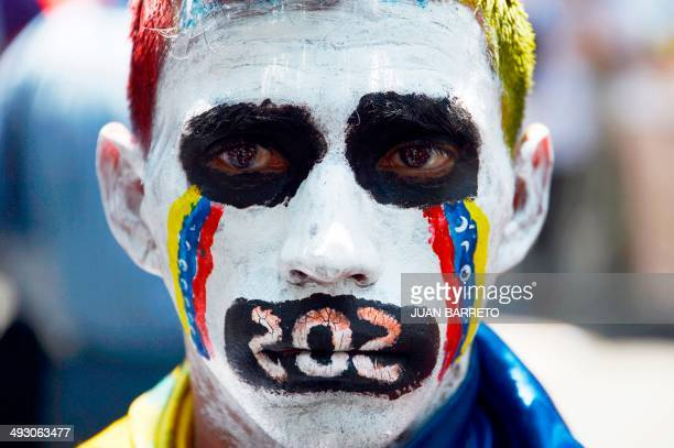 Lawyers and students protest in Caracas on May 21 2014 At least 18 public and private universities in Venezuela began on Thursday a 24hour strike to...