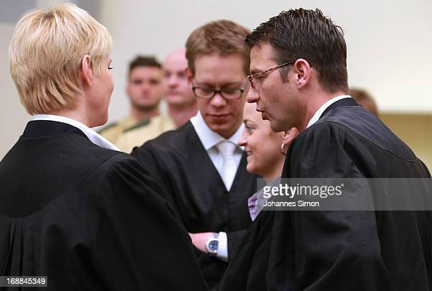 Lawyers Anja Sturm Wolfgang Heer and Wolfgang Stahl chat with their client Beate Zschaepe in the courtroom on day in the courtroom on day four of the...