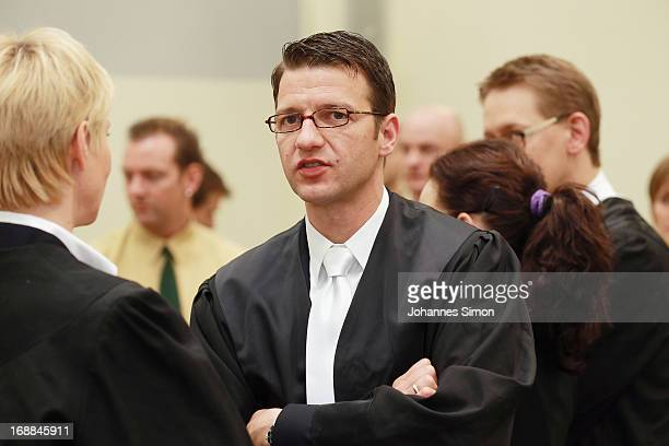 Lawyers Anja Sturm Wolfgang Stahl and Wolfgang Heer protect their client Beate Zschaepe against press photographers in the courtroom on day four of...