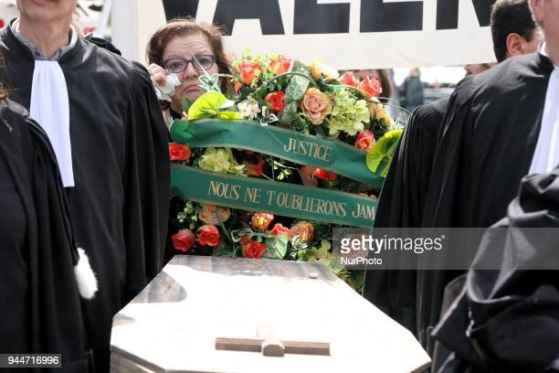 Lawyers carry a coffin for French Justices funeral during a demonstration of lawyers registrars and magistrates place du Châtelet in Paris on April...