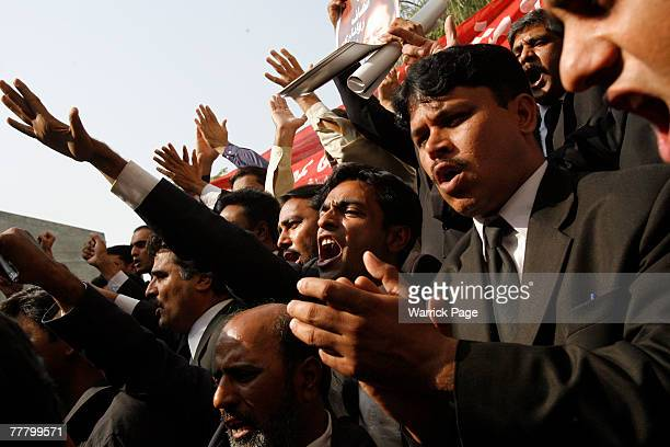 Lawyers chat antigovernment slogans at the district courts on November 8 2007 in Islamabad Pakistan Pakistani President Pervez Musharraf announced...