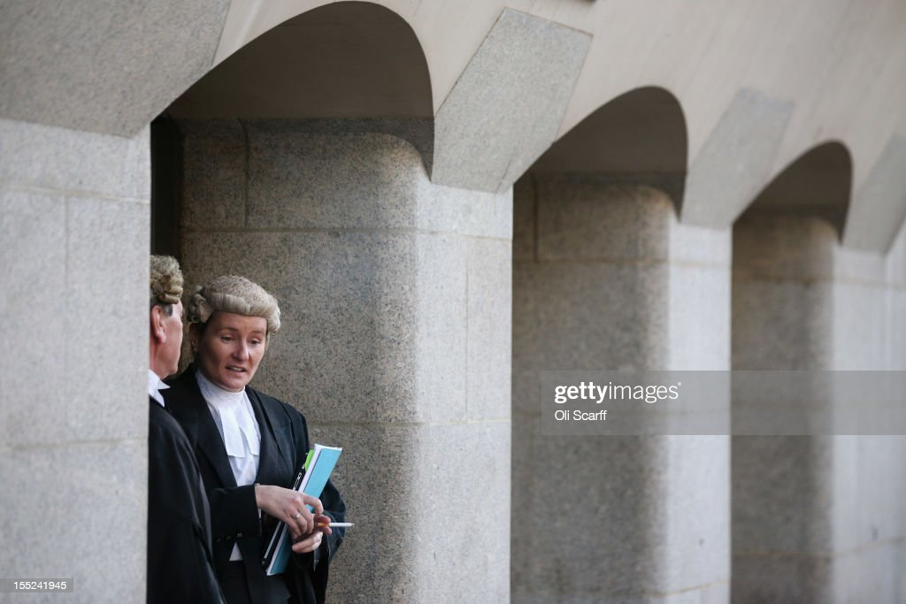 Lawyers Chat and Smoke Cigarettes Outside the Old Bailey : News Photo