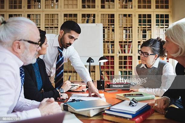 Lawyers discussing in meeting at library
